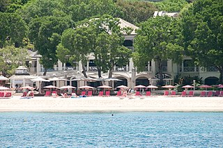 Sandy Lane (resort) A Barbados luxury resort, Sandy Lane is world famous for its peaceful setting, first class service and is perfect for a Caribbean holiday.