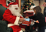 Santa Claus greets airmen, families at post office 121217-F-AK347-002.jpg