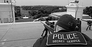 "United States Secret Service Uniformed Division - A U.S. Secret Service ""counter-sniper"" marksman on top of the White House's roof, armed with a sniper rifle."