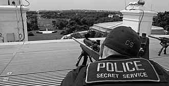 Secret Service counter-sniper marksman on top of the White House's roof, armed with a sniper rifle Secret Service on White House roof.jpg