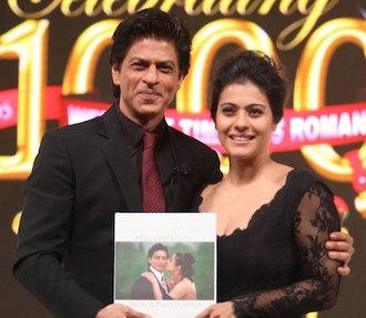 Shah Rukh Khan - Khan with co-star Kajol in 2014 celebrating 1000 weeks continuous showing of their film Dilwale Dulhania Le Jayenge