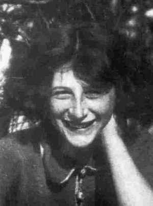 Simone Weil - Weil at age 13. The photograph was taken during a family holiday to Belgium, where she was laughing with her brother André.
