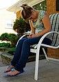 Sitting female teen texting.jpg