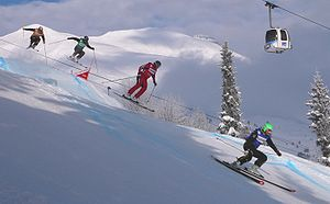Ski cross - Ski Cross competitors navigating a jump at the 2010 World Cup