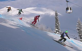 Ski cross timed skiing competitions on courses with both naturally occurring terrain and artificial features (e.g. big-air jump, high-banked turn), in which many skiers race at the same time; intentional contact with other competitors causes disqualification