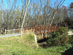 Wallkill Valley Rail Trail - A footbridge connecting the parking area of the Sojourner Truth park with the trail