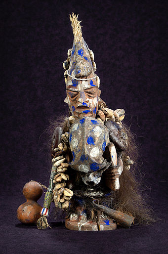 Statue of Sopona, the Yoruba god thought to cause the disease Sopona.jpg