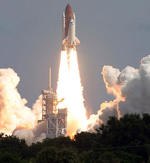 Space Shuttle Atlantis roars off the launch pa...