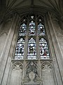 Stained glass window above an urn on the north wall at Winchester Cathedral - geograph.org.uk - 1164323.jpg