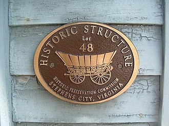 Newtown–Stephensburg Historic District - A Historic Preservation Commission plaque, that all buildings carry, in the Newtown–Stephensburg Historic District in Stephens City.