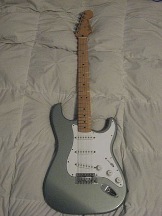 Pickguard - Fender Stratocaster showing extensive white pickguard