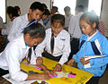 Students learn geography with jigsaw map of Laos.jpg