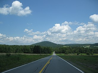 Orson, Pennsylvania - Sugarloaf Mountain, center-left, as seen from East Ararat on Crosstown Highway between Orson and PA-171, facing northeast. The NEP cell tower and a few buildings that are part of ILC can also be seen in the distance, center-right.