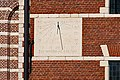 Sundial at the Sint-Dimpna church in Geel Belgium.jpg