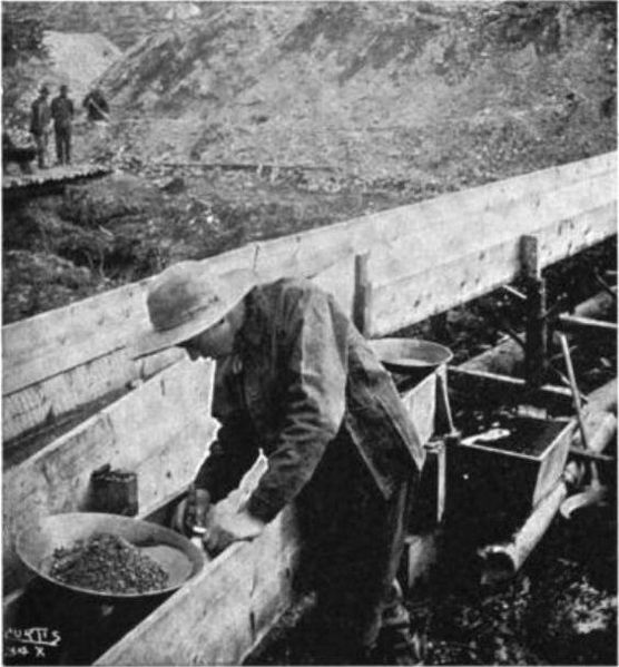 File:Taking gold out of a sluice box.jpg