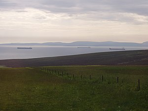 Scapa Flow - Petroleum tankers wait at anchor in Scapa Flow. The calm waters, relative to the North Sea, provide a safe harbour for the oil terminal at Flotta