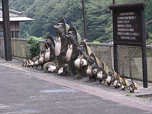 Human–animal hybrid - This image depicts a set of Tanuki statues on the side of a Japanese road.