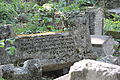 Tchufute Kalei fallen tombstones result of earthquakes.JPG
