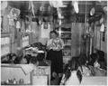 Teacher standing in front of class showing pictures at day school - NARA - 295159.tif