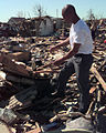 Terry Hardy looks with amazement at what use to be his home at how he and his wife and child survived in the under all that rubble following an F-5 tornado that swept through Oklahoma City DF-SD-00-03238.jpg