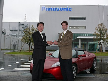 Panasonic Energy Company President Naoto Noguchi presented Tesla CTO JB Straubel with the first production run of lithium-ion cells from Panasonic's facility in Suminoe, Japan. - Tesla Motors