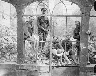 17th (Northern) Division - Officers of the 7th (Service) Battalion (Pioneers), York and Lancaster Regiment, in a ruined building in Arras, 30 April 1917.