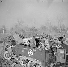 "Two British M3 GMCs used for indirect fire in a barren field in Northern Italy. The M3 in the foreground was nicknamed ""Acorn Inn"" by its crew."