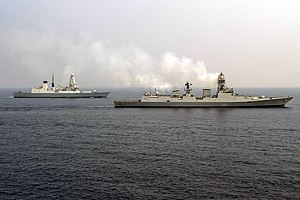 Kolkata-class destroyer - Image: The Indian Navy destroyer INS Kolkata (D63) and the British Navy destroyer HMS Defender (D36) steam alongside the Ticonderoga class guided missile cruiser USS Antietam (CG 54) during an exercise