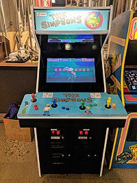 A blue arcade game with The Simpsons characters on it