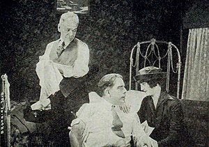 Wellington A. Playter - Wellington A. Playter (center) and Priscilla Dean in The Wicked Darling (1919)