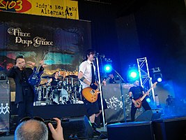 Three Days Grace in 2006. From left to right: Barry Stock, Neil Sanderson, (behind) Adam Gontier and Brad Walst.
