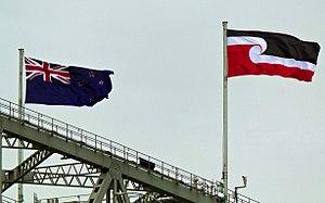 Tino rangatiratanga - The Tino Rangatiratanga flag flying alongside the Flag of New Zealand on the Auckland Harbour Bridge, Waitangi Day, 2012.