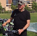 Tom Brokaw checks out a bike at Upper Landing Station (2822822562) (cropped1).jpg