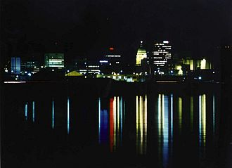 Downtown Topeka skyline at night, seen from the Kansas River (2005) Topeka night skyline.jpg