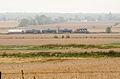 Train in corn field (15156556488).jpg