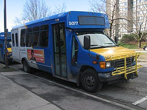 Cutaway van chassis - This TransLink-owned community shuttle bus at the University of British Columbia, University Endowment Lands, BC, Canada, is built upon a Ford cutaway van chassis with a body added by a second stage manufacturer.