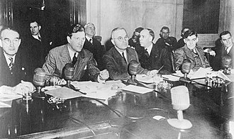 Truman Committee - Senators, counsel, witnesses, and visitors at a 1943 meeting of the Truman Committee. Senator Harry S. Truman is at the center.