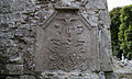 Tulsk St. Patrick's Priory South Transept Crucifixion Plaque with Coat of Arms of O'Conor Roe 2014 08 29.jpg