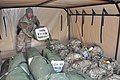 U.S. Army Staff Sgt. Jeff D. Kosaka, with Headquarters and Headquarters Company, 1st Battalion, 294th Infantry Regiment, Guam Army National Guard, loads duffel bags and ruck sacks onto a vehicle as Task Force 131215-Z-WM549-006.jpg