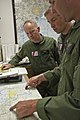 U.S. Coast Guard Lt. Audie Andry, Lt. Cmdr. Rob Donnel and Lt. Matthew Hunt, all MH-60 Jayhawk helicopter pilots assigned to the Aviation Training Center Mobile, Ala., review charts before departing from Houston 120829-G-EK967-002.jpg