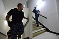 U.S. Navy Master-at-Arms 2nd Class Manuel Mendoza climbs the stairs of a tower at Naval Air Facility Atsugi, Japan, Sept 120911-N-TO330-0347.jpg