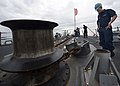 U.S. Navy Seaman Shawn O'Conner watches the anchor chain during a sea and anchor detail aboard the guided missile destroyer USS Mustin (DDG 89) in Pyeongtaek, South Korea, Oct. 7, 2013 131007-N-CG241-138.jpg
