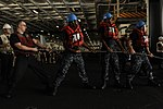 U.S. Sailors heave a line in the hangar bay of the aircraft carrier USS Nimitz (CVN 68) during a replenishment at sea June 16, 2013, in the Gulf of Oman 130616-N-IB033-003.jpg