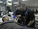 U.S. Sailors in the medical department of the amphibious assault ship USS Bataan (LHD 5) assess a Turkish mariner recovered by a Bataan search and rescue team in the Aegean Sea March 8, 2014 140308-N-AO823-115.jpg