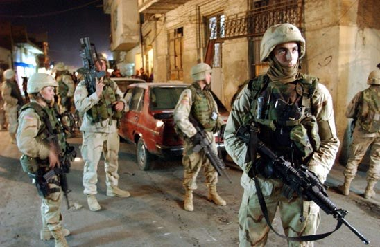 U.S. soldiers from Scout Platoon, HHC, 1st Battalion, 36th Infantry Regiment, 1st Armored Division during Operation Iron Hammer in 2003