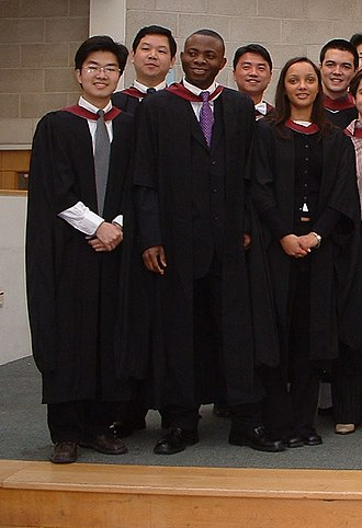 Academic dress of the University of Bristol - Master's gown. Note the amendment at the bottom of the sleeves.