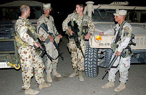 Airfield Defence Guards - Two Airfield Defence Guards (at left and second from the right) with members of the USAF 447th Expeditionary Security Forces Squadron at Baghdad International Airport