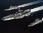 USS Enterprise (CVN-65) with Truxtun (CGN-35) and Arkansas (CGN-41) 1989.jpg