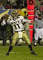 US Navy 031206-N-9693M-511 Navy quarterback Craig Candeto looks for a receiver downfield during the 104th Army Navy Game.jpg