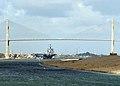 US Navy 040205-N-5405H-003 The nuclear powered aircraft carrier USS Enterprise (CVN 65) passes under Friendship Bridge as she transits the Suez Canal.jpg